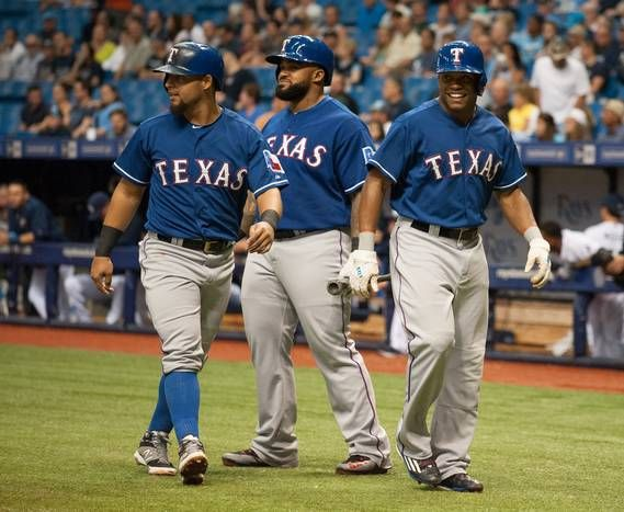 ST. PETERSBURG, FL - MAY 7: Rougned Odor #12 of the Texas Rangers & Delino DeShields Jr. #7 of the Texas Rangers of the Texas Rangers congratulate one another after scoring in the second inning against the Tampa Bay Rays. Prince Fielder #84 of the Texas Rangers (middle) was next to bat on May 7, 2015 at Tropicana Field in St. Petersburg, Florida. (Photo by Cliff McBride/Getty Images)
