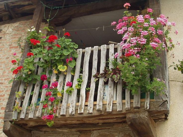 Traditional macedonian balcony with a flower garden for Traditional balconies