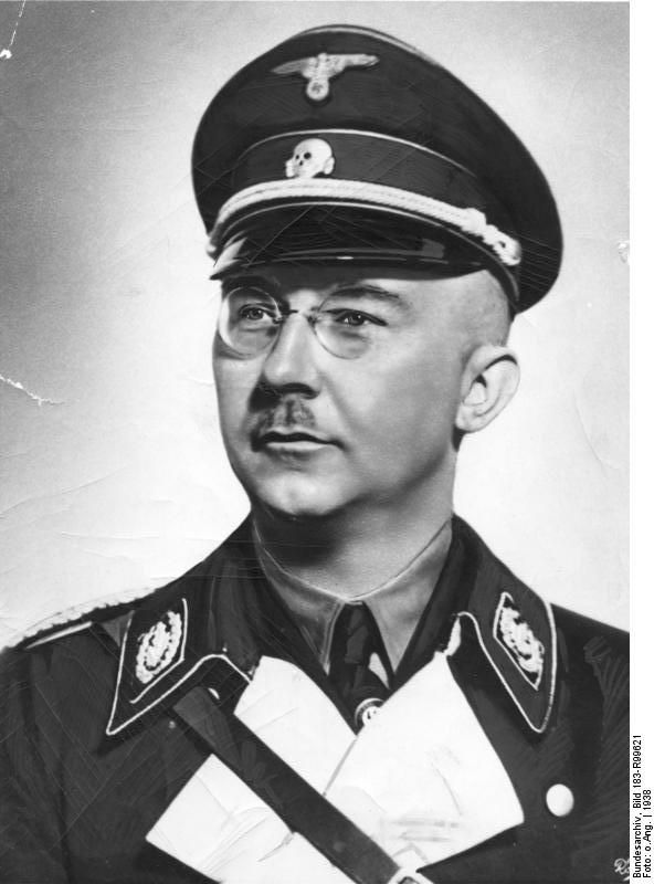 "Official portrait of Heinrich Himmler, 1938. Himmler prefered pictures with his cap on because he apparently believed that he looked more of a ""leader"" when he wore his death head's top cover. Portraits of him appearing in SS offices had to be approved by the Reichsfuhrer SS personally."