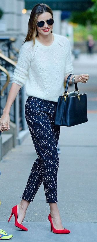 Dotted blue pants and red high heels |