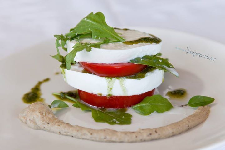 @ Impressions Restaurant . What about a Caprese salad with bufala mozzarella from Serres, fresh rucola and aubergine mousse for a starter - or just as a little meal ?