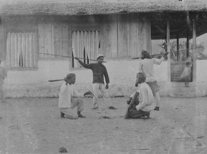 Buru people demonstrating spearing techniques
