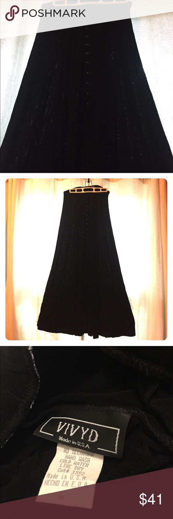 👠Black maxi skirt with sexy front slit 💃🏻 A black maxi skirt with  a row of black buttons and a sexy slit down the front, this light wait skirt will swish and swirl as you walk or dance.  Dress it down with tall black boots for work or wear it out in the evening with heels, this versatile and sophisticated skirt will quickly become a favorite. Vivyd Skirts Maxi