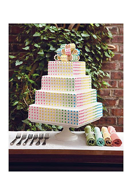 Brides.com: . This modern square-shaped confection is covered in colorful royal icing candy dots.  Around $6 per slice, Lochel's Bakery