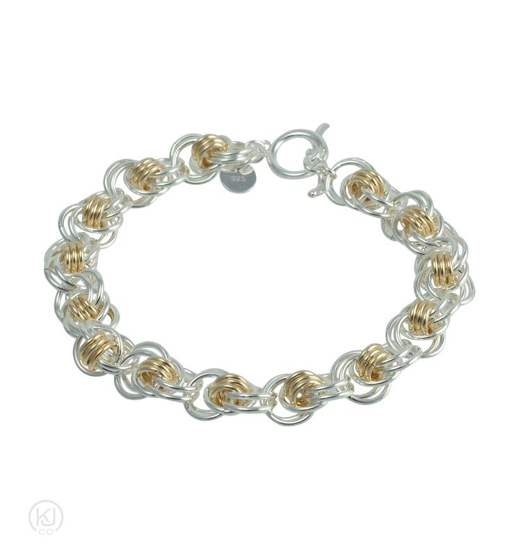 Aylin – Ocean Waves Bracelet – Let your cares drift away in the calming ocean waves as they adorn your wrist in either Sterling Silver or 14kt Gold Filled combination with Sterling Silver for a magnificent contrast. With large orbiting rings layered over 3 connecting smaller rings at the core of this bracelet to create the endless rolling waves of the ocean.  Elegant and timeless beauty.