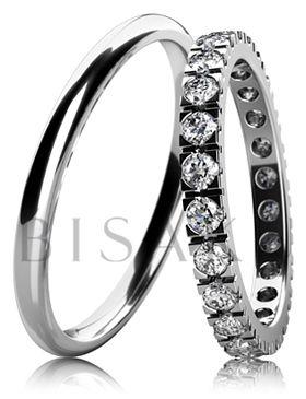 BD6-8 Elegantní snubní prsteny z bílého zlata v lesklém provedení. Dámský prsten je po celém obvodu zdoben kameny. Vzhledem k jemnému a elegantnímu provedení dámského prstenu, lze tento model snadno kombinovat se zásnubním prstenem. #bisaku #wedding #rings #engagement #svatba#snubni #prsteny #design