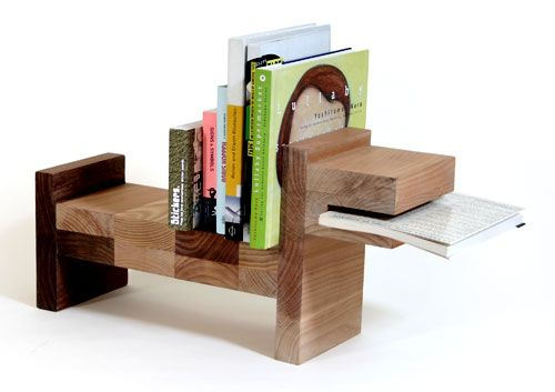 "Pack of dogs. This funny looking bookshelf tends more towards play and joy than functionality but I like the design and I can't agree more that this ""pack of dogs"" will keep my books safe and probably exactly where I left them."