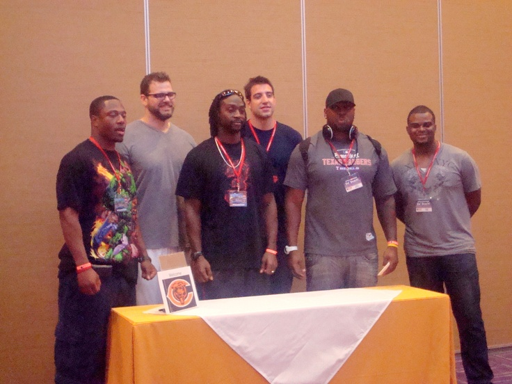 Players Nick Roach, Gabe Carimi, Charles Tillman, Matt Spaeth, and Henry Melton, with Jason Goff from WSCR Radio