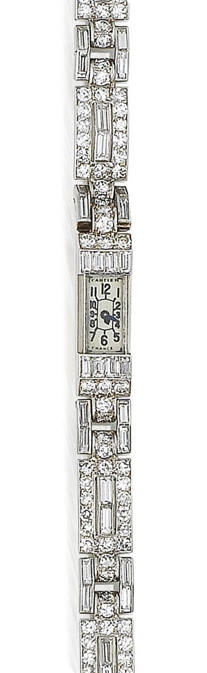 An art deco diamond wristwatch, by Cartier, circa 1925  The rectangular dial with Arabic numerals between courses of baguette and brilliant-cut diamonds, to an articulated pierced baguette, single and brilliant-cut diamond strap, diamonds approximately 6.05 carats total, dial signed Cartier, strap signed Cartier London, length 17.2cm. Once belonged to Miss Eleonora Sears