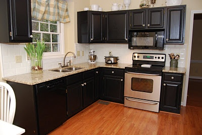 pretty black kitchen cabinets with contrasting white walls
