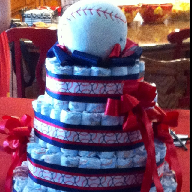 Baseball Themed Baby Shower. This Centerpiece Is Made Up Of Disposable  Diapers, A