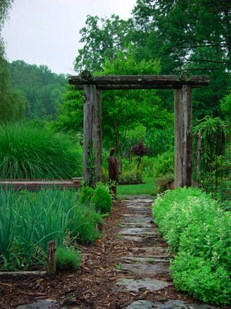 This might be a touch more rustic than I really want, but I love the idea of an arbor and a path surrounded by green living things that are full of various textures.