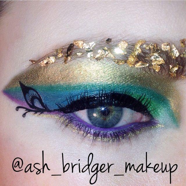 Peacock inspired eye using Ruby Flakes on my brow from Ruby Robyn Cosmetics... www.rubyrobyncosmetics.bigcartel.com