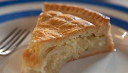 Cheese n Onion pie.  60g/2oz butter, cut into small pieces.  60g/2oz lard, cut into small pieces.  200g/7oz self-raising flour, plus extra for dusting.  pinch salt.  For the filling.  25g/1oz butter.  3 onions, roughly sliced.  salt and freshly ground white pepper.  250g/9oz Lancashire cheese, (1/2 Feta & 1/2 strong cheddar substitute) coarsely grated.  milk, for sealing and glazing.