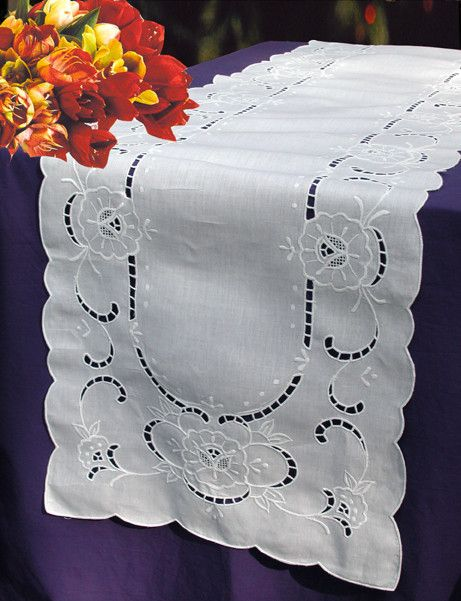 "The choice of discriminating hostesses for more formal affairs. This Cherry Blossom runner (16x72"") is handcrafted with cutwork embroidered cherry blossom on white linen. Perfect on the dinner table o"