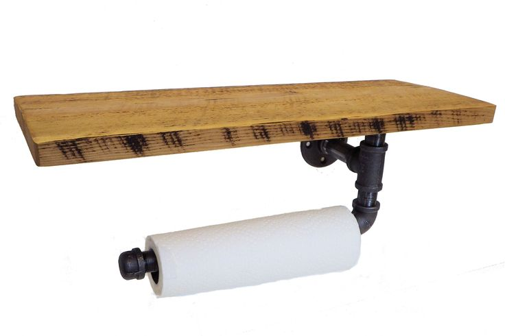 Reclaimed industrial paper towel holder. The holder measures 22 inches long by 8 inches deep by 8 inches high. Holds one roll of paper towels. Finished in lacquer.