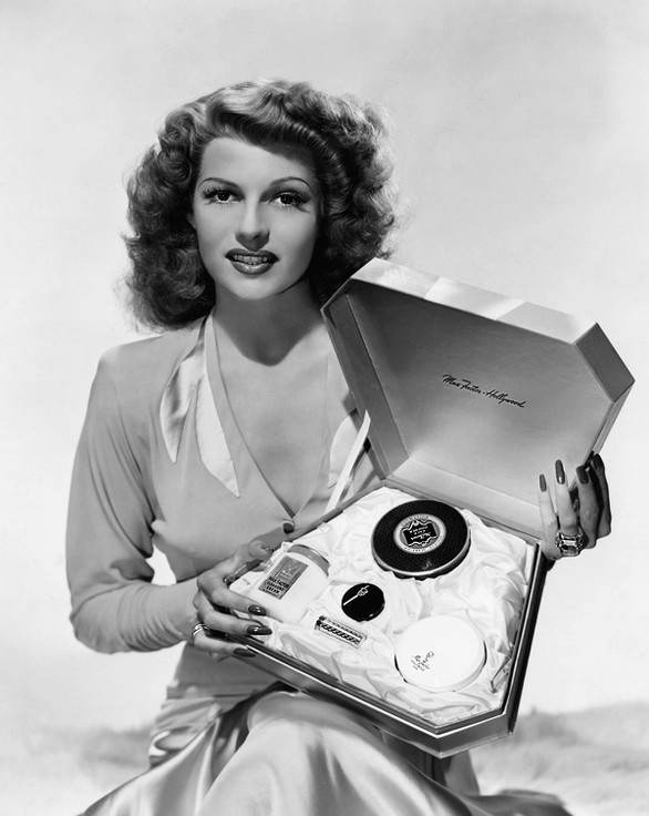 Rita Hayworth modelling with a case of Max Factor make up early 1940's