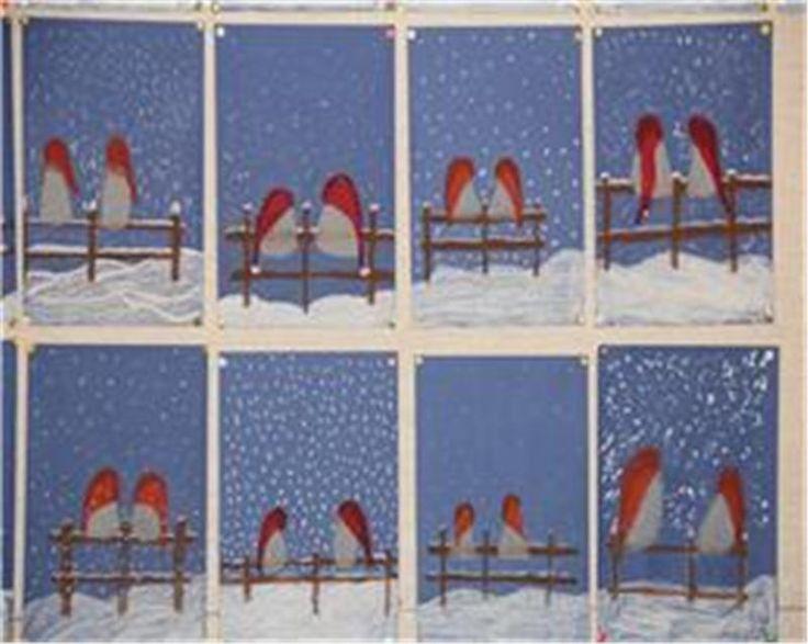 roodborstjes op het hek, op blauw papier met waskrijt.