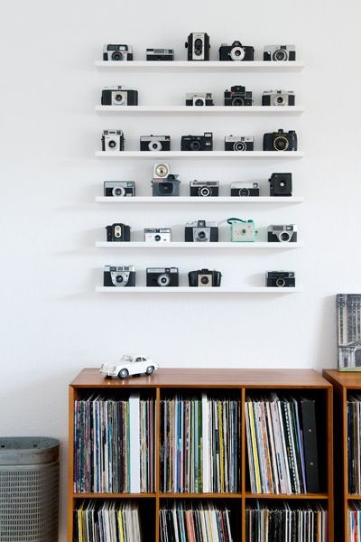 Cameras! Love this! though I would have pictures on the shelves to add to the flavor of photography.