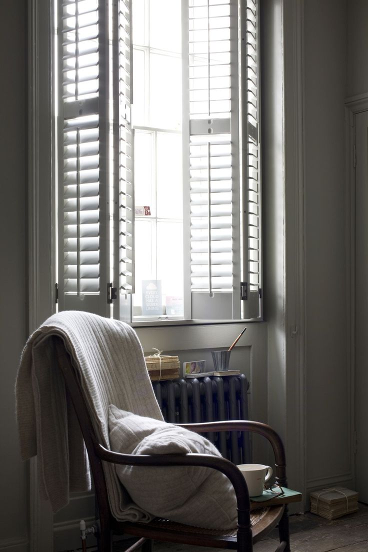 Window  Slatted plantation shutters.