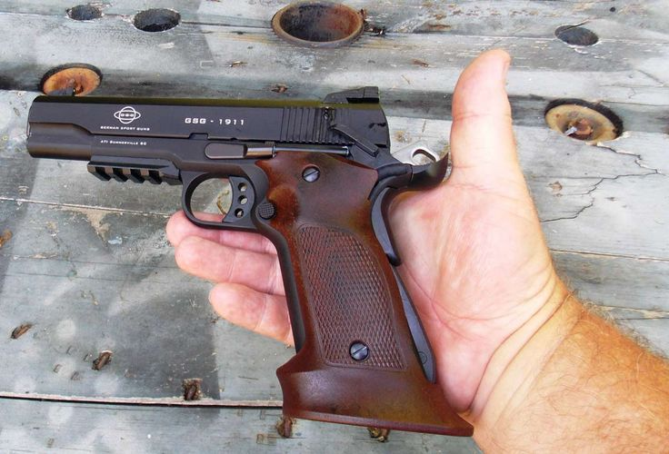 ATI 1911 .22 in a man's hand, highlighting the grip