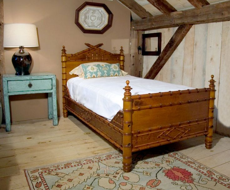 American furniture makers of the late 19th century joined the craze in  England and France for the decorative motifs of the Far East. Faux bamboo  turnings, so popular back then, continue to appeal to homeowners and  designers today with their light-hearted, informal and whimsical charm. Our  New Orleans Faux Bamboo Bed has a French flair with its jaunty peaked  headboard and faux bamboo molded rails. Offered here in Spanish Cedar with  traditional finish.  Dimensions: Headboard 51.5''H…