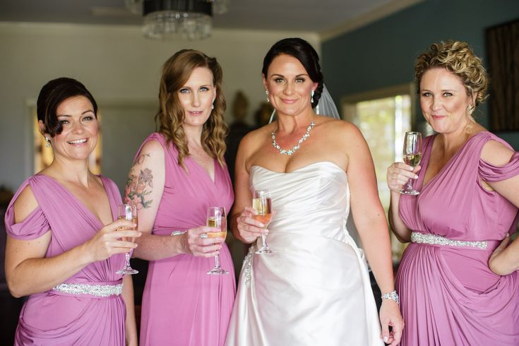 Kristen, the stunning bride, dressed her bridesmaids in different Pia Gladys Perey dresses. The stunners on the far left and far right wore our Darla Dress, an elegant full length dress that features a v-neckline, cap sleeves and flattering draped skirt.