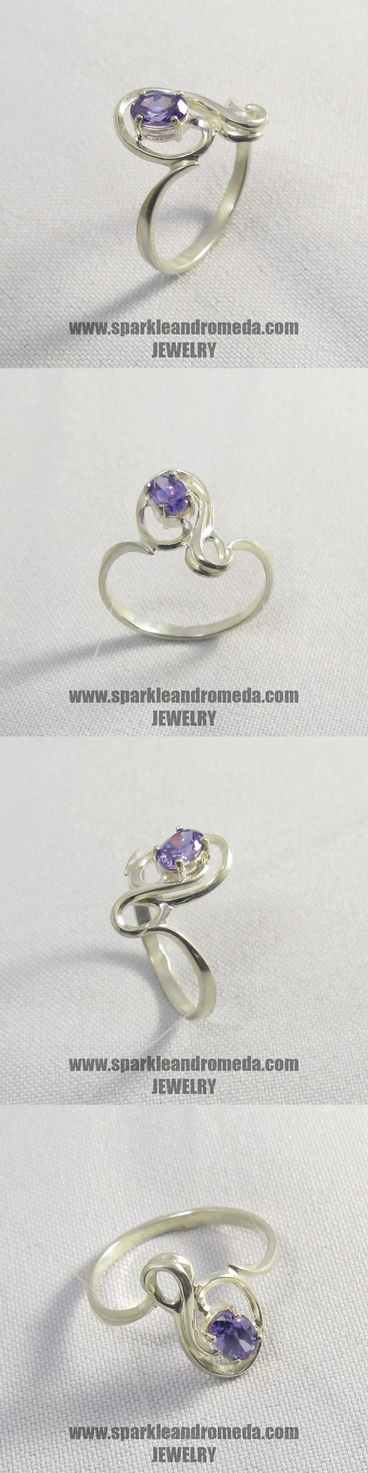 Sterling 925 silver ring with 1 oval 6×4 mm violet amethyst color cubic zirconia gemstones.