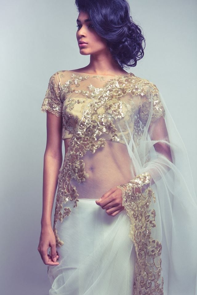 white and gold Saree by Neeta Lulla featured in Vogue India October 2013 - border design