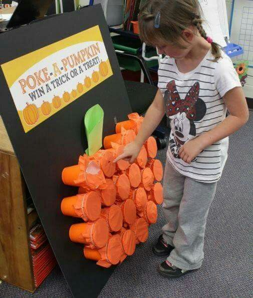 Poke a pumpkin. Will you get a trick. Put goodies in orange solo cups. Cover with orange tissue paper & wrap a rubber band around to hold in place glue cups too a black board and give it a steam too make it look like a pumpkin.