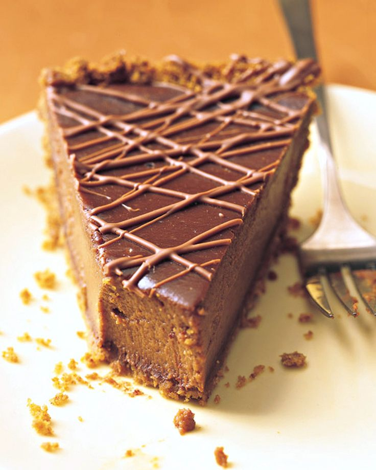 Triple-Chocolate Pumpkin Pie | Martha Stewart Living - A hidden layer of bittersweet chocolate coats the crumb crust, semisweet imparts a silken smoothness to the customary custard, and a drizzle of milk chocolate on top teases the eye -- and the appetite.