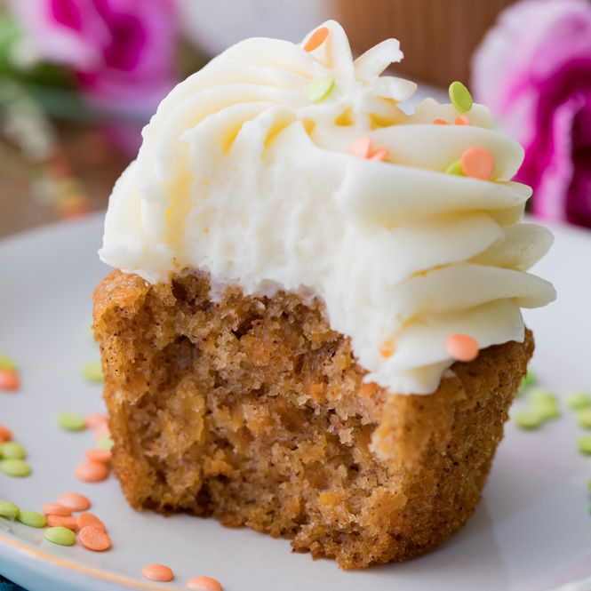 Soft, fluffy, and moist carrot cake cupcakes! Made completely from scratch with real grated carrots and the option to add nuts or raisins, these cupcakes are always a hit! Make sure to top them off with the absolute best cream cheese frosting.
