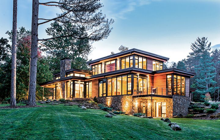 Windsor Pinnacle wood/clad windows. Black clad, direct set, casement, and in-swing patio doors. Exterior.