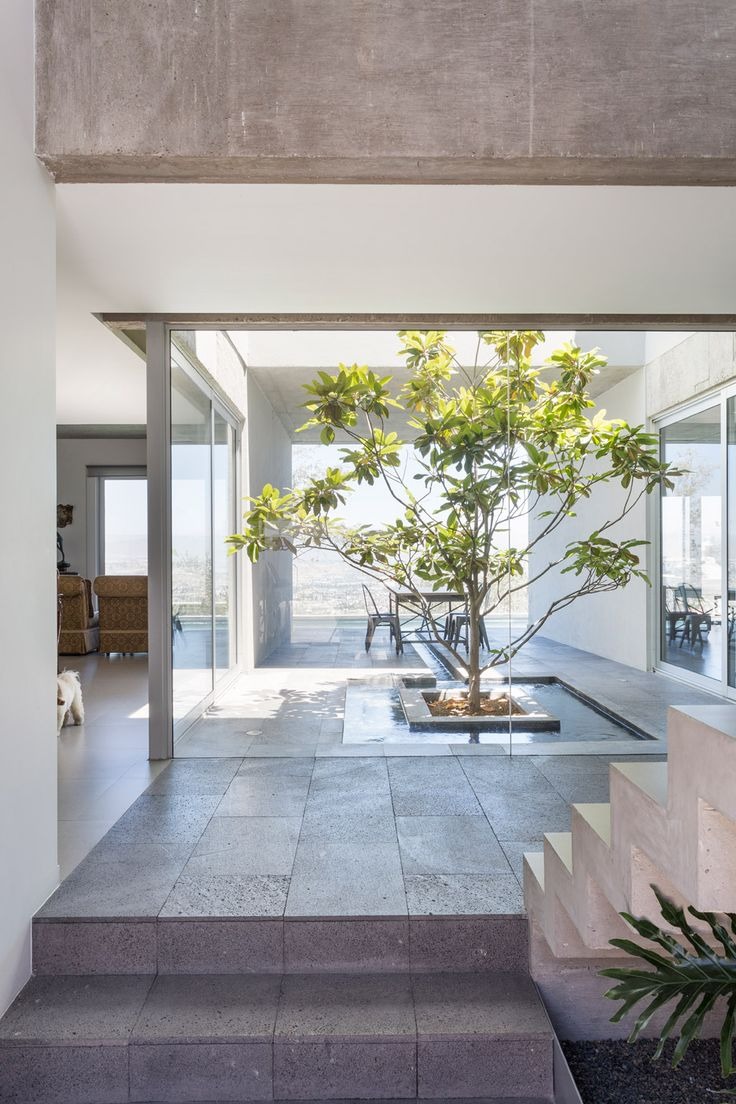 This concrete house in Mexico is organised as a nine-square grid with a courtyard at its centre.