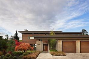 For their new lakeside home, the couple wanted a design that would recollect those of Frank Lloyd Wright and Roland Terry; Northwest contemporary with Asian undertones. And with the low profile, flat roof, horizontal wood siding and clerestories, they got it.