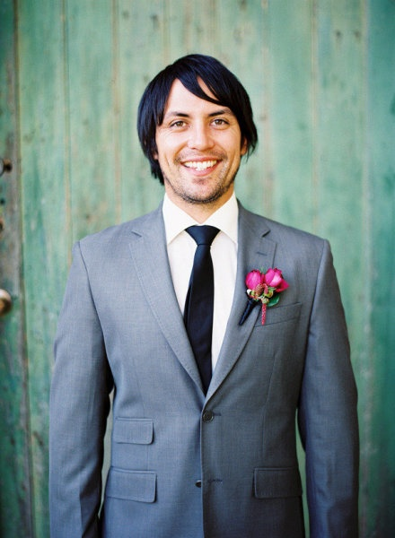 grey suit and flowers