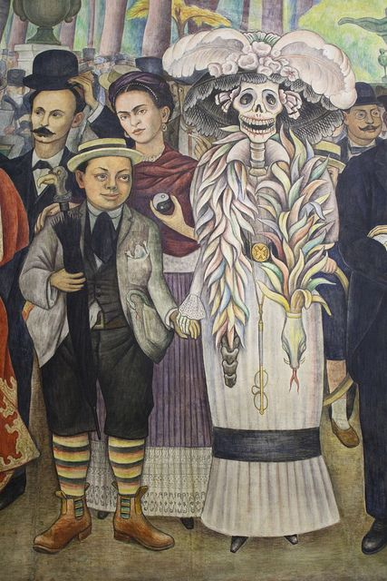 "Diego Rivera with the figure of ""La Catrina"" (Painting  entitled "" A Sunday Afternoon in Alameda Park"")."