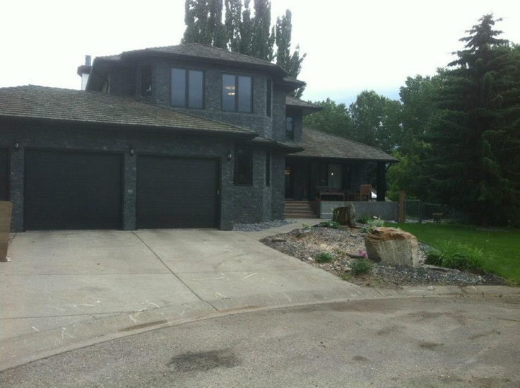 After Completed Exterior Reno, New Windows, New Doors, New Stone. www.capitall.ca