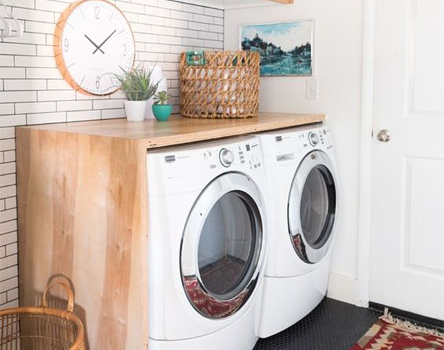 Small space laundry room? Use the top of your washing machine + dryer as a prep space or storage area with this easy DIY wood shelf hack.