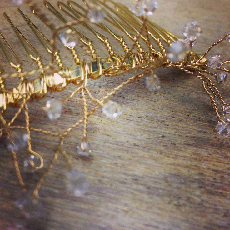 Hand wired Swarovski crystal starburst bridal comb under construction.