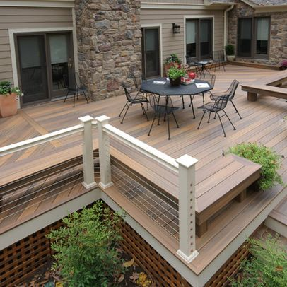 a raised deck with under deck skirt contemporary cable rails and built in seating decking ideaspatio