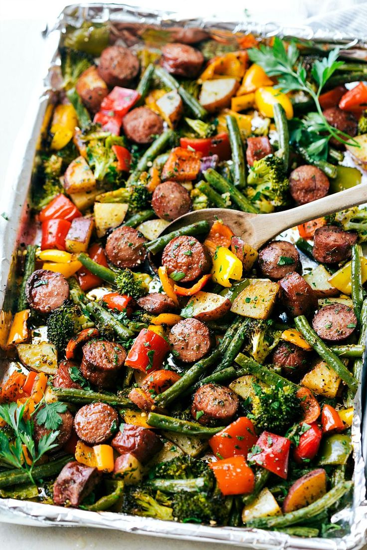 Roasted veggies with sausage and herbs all made and cooked on one pan. 10 minutes prep, easy clean-up! Recipe via chelseasmessyapron.com  Took 30 mins prep for me. Used parchment and no red pepper flakes. Use less paprika and blk pepper next time. Maybe a little seasoning salt. Did 15 mins, flip, amd 15 mins. Used yellow butter potatoes and cut into 4th or 6ths. Cut smaller next time. SOOo good!