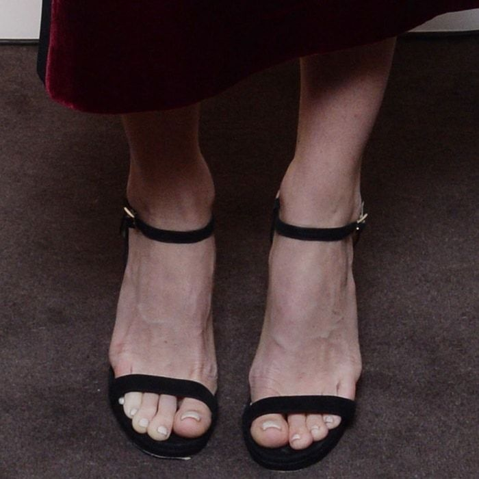 Alice Eve showing off her feet in black ankle strap sandals