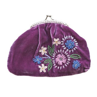 One of the sweetest little coin purses, small, yet perfectly formed, in luxurious velvet.