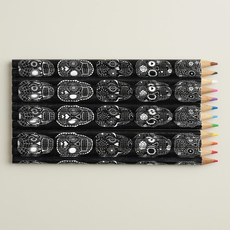 Sugar Skull Colored Pencils, Set of 12 | Each pencil features detailed black and white calavera sugar skull artwork and fits neatly in a decorative pencil tin.