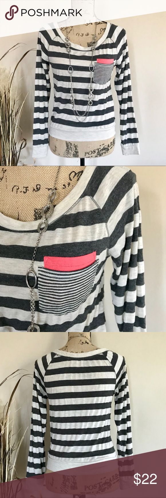 """Neutral striped tee Cute and comfy long sleeve top by Rewind. Brown and tan oatmeal striped with a splash of melon accent pocket. Wide neckline, banded hem and cuffs. Size M. Excellent condition. 50% polyester 50% rayon. Machine wash. Approx measurements, bust 16 1/2"""", length 21"""". Hits at natural waist. ⭐️ Rewind Tops Tees - Long Sleeve"""