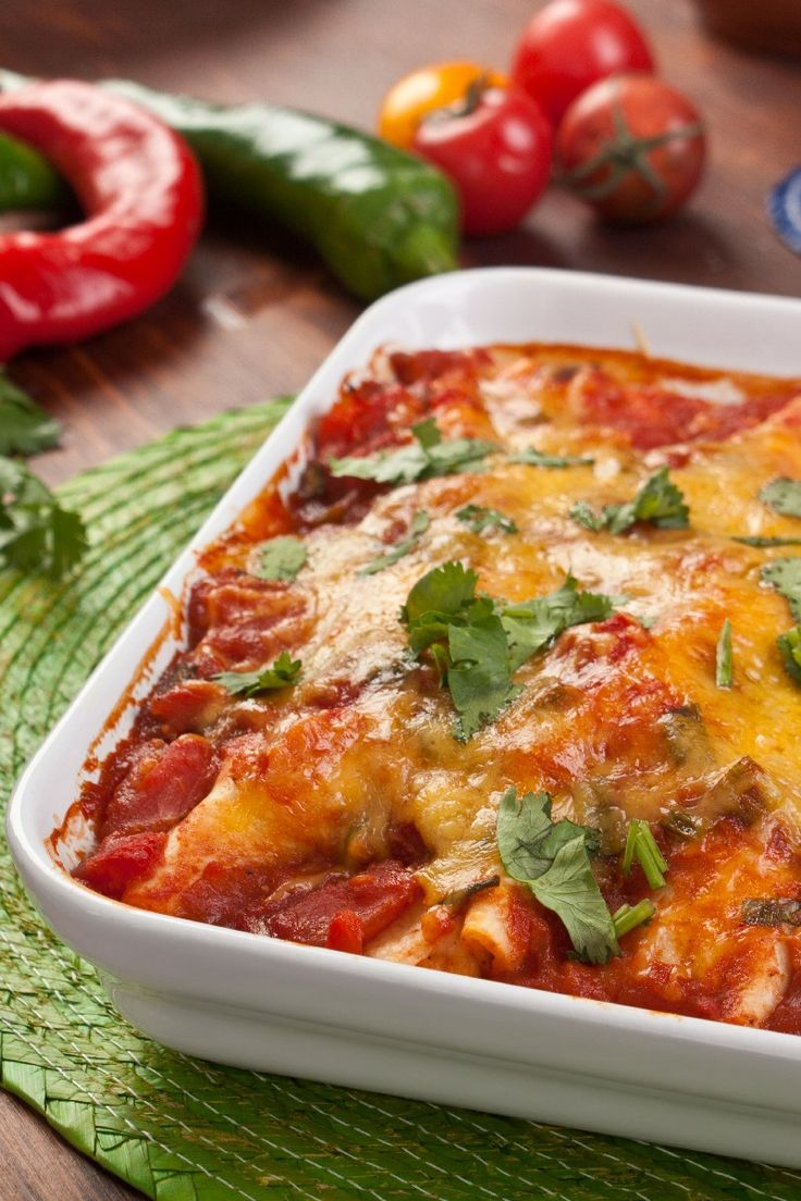 Recipe including course(s): Entrée; and ingredients: beans, chicken, cooking spray, corn tortilla chips, green pepper, lettuce, low-fat cheddar cheese, onion, reduced-fat sour cream, salsa, tabasco sauce, tomato sauce, whole wheat tortilla