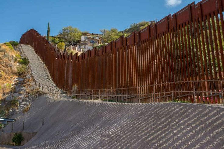 First phase of Trump border wall gets $18 billion price tag, in new request to lawmakers  - January 5, 2018.  FILE: The border wall at the US - Mexico border in the city of Nogales, Arizona.