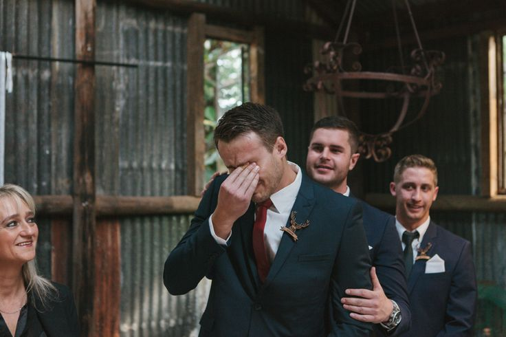 Grooms reaction when he sees his bride walk down the isle - Le Sueur Photography