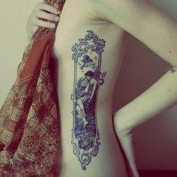 Intricate art nouveau rib tattoo - looks like a Mucha